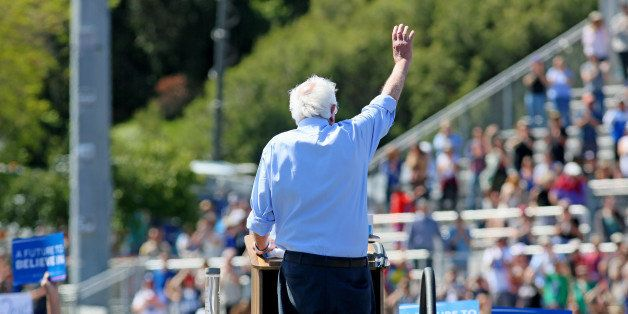 Democratic presidential candidate Sen. Bernie Sanders, I-Vt., waves to supporters at a rally on Sunday, May 22, 2016, in Vist
