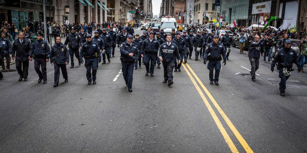 MIDTOWN MANHATTAN, NEW YORK CITY, NEW YORK, UNITED STATES - 2016/03/19: Policemen flooded the street during  the anti-Trump r