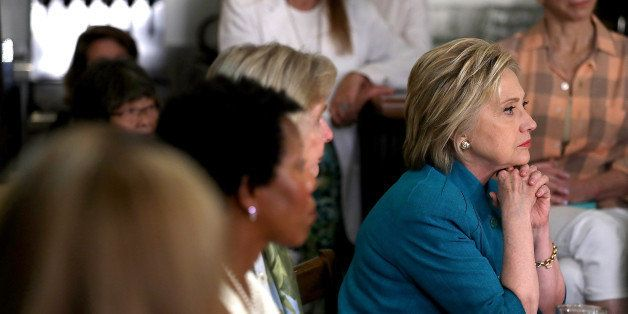 SANTA BARBARA, CA - JUNE 04: Democratic presidential candidate former Secretary of State Hillary Clinton (R) looks on during