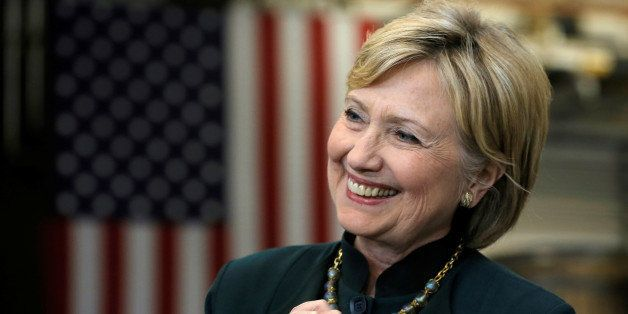 U.S. Democratic presidential candidate Hillary Clinton smiles as she listens to her introduction at a campaign event in Athen