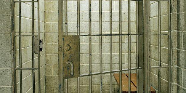 Empty prison cell with door open