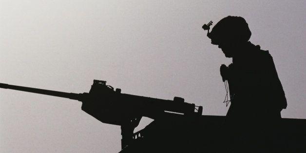 Airman prepares for convoy escort mission, Mosul, Iraq