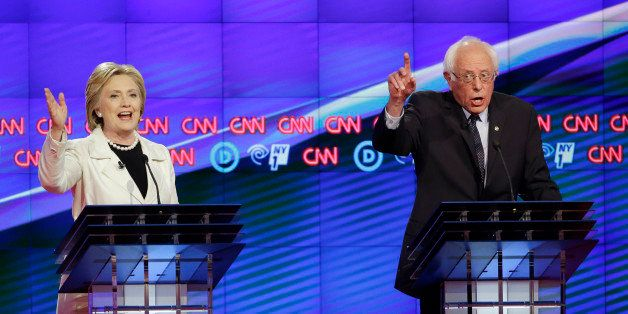 Democratic presidential candidates Sen. Bernie Sanders, I-Vt., right, and Hillary Clinton speak during the CNN Democratic Pre