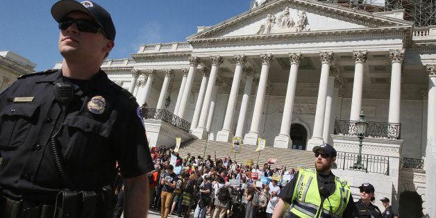 WASHINGTON, DC - APRIL 18:  US Capitol Police give protesters a warning to move away from the front of the Capitol or get arr