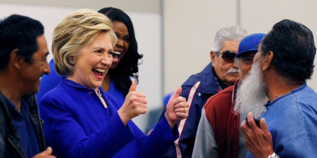 U.S. Democratic presidential candidate Hillary Clinton gestures during a campaign stop at a community center in Compton, Cali