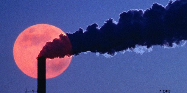 Smoke emerging from smokestack at chemical plant, evening