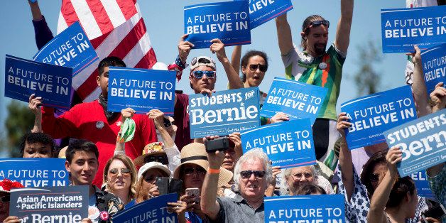 Supporters of Democratic presidential candidate Sen. Bernie Sanders, I-Vt., cheer during a campaign rally at the Cubberley Co