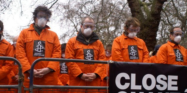 Amnesty International demonstrates in front of the US Embassy in London on 11 January 2007 for the closure of the US detentio