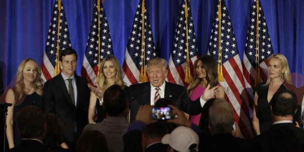 Republican U.S. presidential candidate Donald Trump is surrounded by members of his family as he speaks at a campaign event o