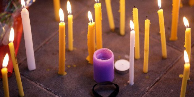BANGKOK,  THAILAND - JUNE 13: A black ribbon sits on the floor amidst candles during a vigil for the attack at the gay club i