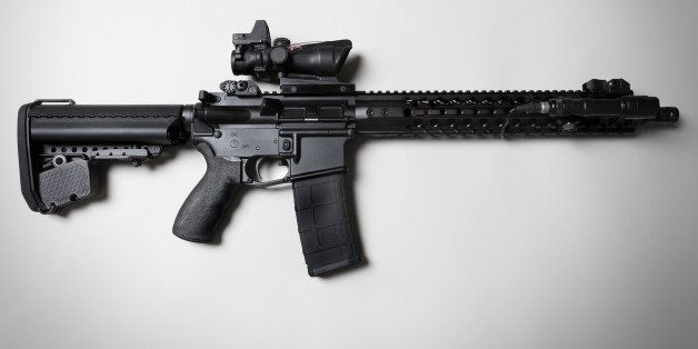 An ar-15 combat / assault rifle shot on a white backdrop with dramatic lighting.