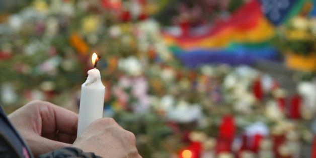 BERLIN, GERMANY - JUNE 18:  A mourner attends a vigil for victims of a shooting at a gay nightclub in Orlando, Florida nearly