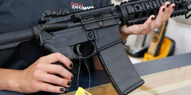 SPRINGVILLE, UT - JUNE 17:  Courtney Manwaring holds an AR-15 semi-automatic gun at Action Target on June 17, 2016 in Springv