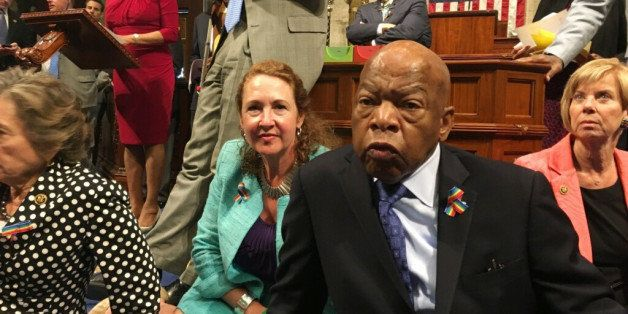 This photo provided by Rep. Chillie Pingree,D-Maine, shows Democrat members of Congress, including Rep. John Lewis, D-Ga., ce