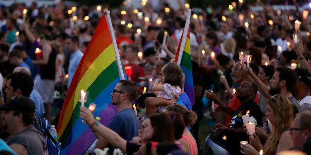 Supporters of the victims of the recent mass shooting at the Pulse nightclub attend a vigil at Lake Eola Park, Sunday, June 1