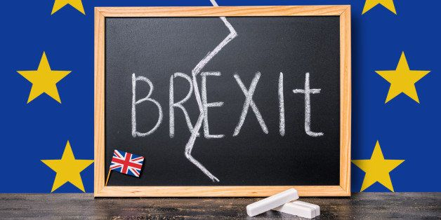 Brexit UK EU referendum concept cut Great Britain apart from rest of European union with flags and handwriting text written i