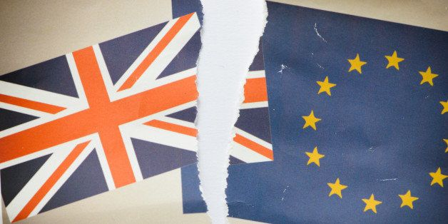 Image of a family snap photo showing the United Kingdom Union Jack and European Community flags - ripped in two as a divorce