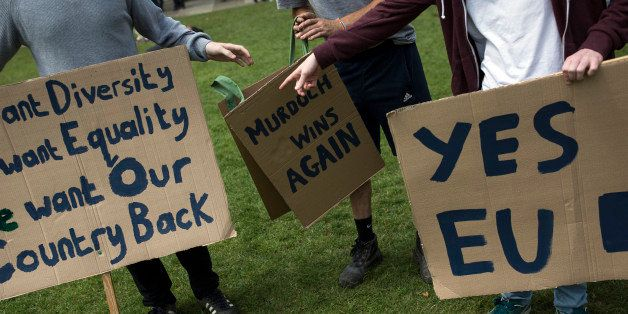 LONDON, ENGLAND - JUNE 25:  A small group of young people gather to protest on Parliament Square the day after the majority o