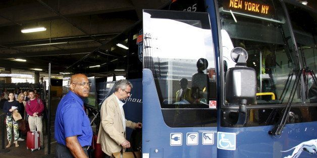 Commuters board Greyhound bus en route to New York City, at the Union Station in Washington May 13, 2015. Rescue workers on W