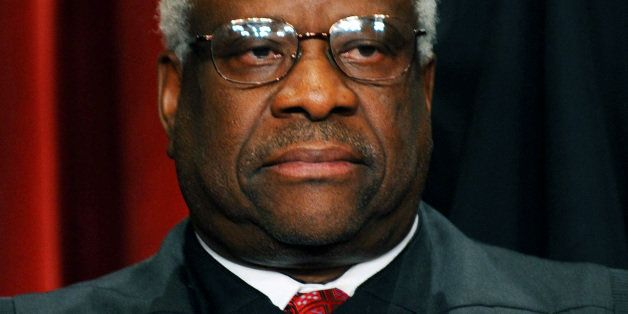 US Supreme Court Associate Justice Clarence Thomas participates in the courts official photo session on October 8, 2010 at th