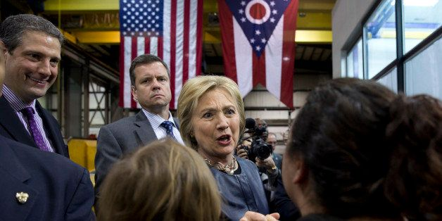 Democratic presidential candidate Hillary Clinton, joined by Rep. Tim Ryan, D-Ohio., left, greets people in the audience duri