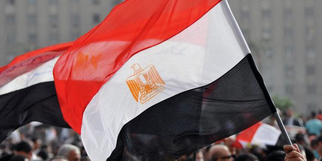 An Egyptian flag is held above in Cairo's Tahrir Square at a rally two weeks after the resignation of President Mubarak.