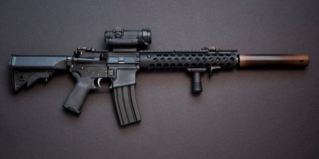 Assault rifle in caliber .223 with high capacity magazine and silencer.
