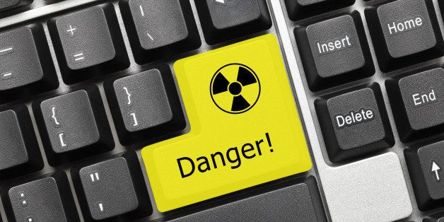 Close-up view on conceptual keyboard - Danger (yellow key with radiation symbol)