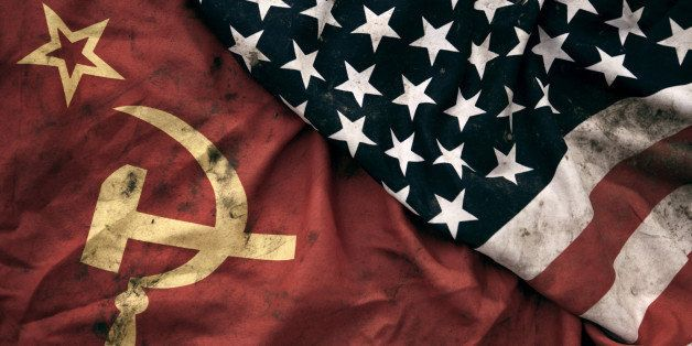 Low key photography of grungy old Soviet Union and United States of America flags. USSR, CCCP, USA.