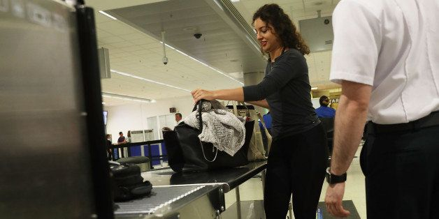 MIAMI, FL - JUNE 02:  Travelers go through the TSA PreCheck security point at Miami International Airport on June 2, 2016 in