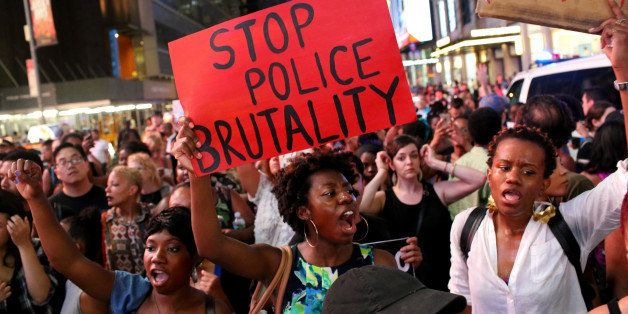 NEW YORK, NY - JULY 07: Activists protest in Times Square in response to the recent fatal shootings of two black men by polic