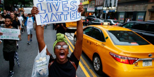 NEW YORK, NY - JULY 8: People take part in a protest on July 8, 2016 in New York City. Police presence was increased around N
