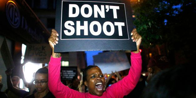 TOPSHOT - A woman holds a banner during a protest in support of the Black lives matter movement in New York on July 09, 2016. The gunman behind a sniper-style attack in Dallas was an Army veteran and loner driven to exact revenge on white officers after the recent deaths of two black men at the hands of police, authorities have said. Micah Johnson, 25, had no criminal history, Dallas police said in a statement. / AFP / KENA BETANCUR (Photo credit should read KENA BETANCUR/AFP/Getty Images)