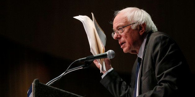 U.S. Democratic presidential candidate and U.S. Senator Bernie Sanders holds up his notes while speaking about his attempts t