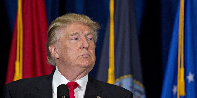 Donald Trump, presumptive 2016 Republican presidential nominee, pauses while speaking during a campaign event on veterans ref