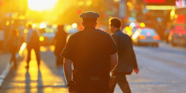 Police officer at sunset in New York City