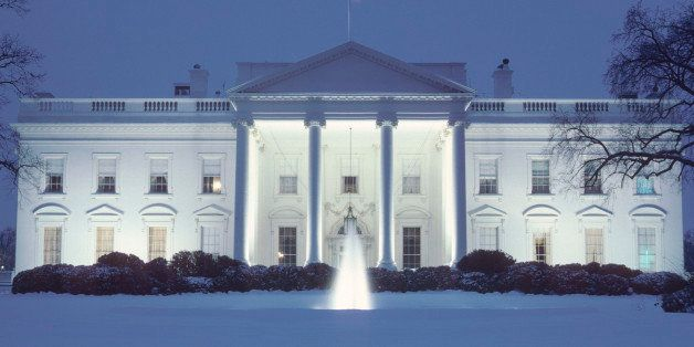 A day long snowstorm covered the North Lawn of the White House, reflecting some of the blue evening sky.