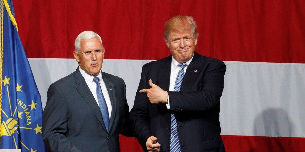 Republican U.S. presidential candidate Donald Trump (R) points to Indiana Governor Mike Pence (L) before addressing the crowd