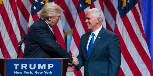Republican presidential candidate Donald Trump, right, introduces Gov. Mike Pence, R-Ind., during a campaign event to announc