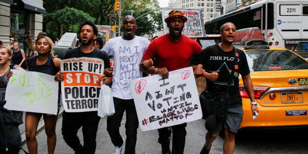 People take part in a protest against the killings of Alton Sterling and Philando Castile during a march in New York July 7,