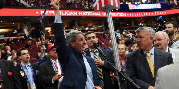CLEVELAND, OH - JULY 18: Former Virginia Attorney General and current Delegate, Ken Cuccinelli, center, removes his credentia