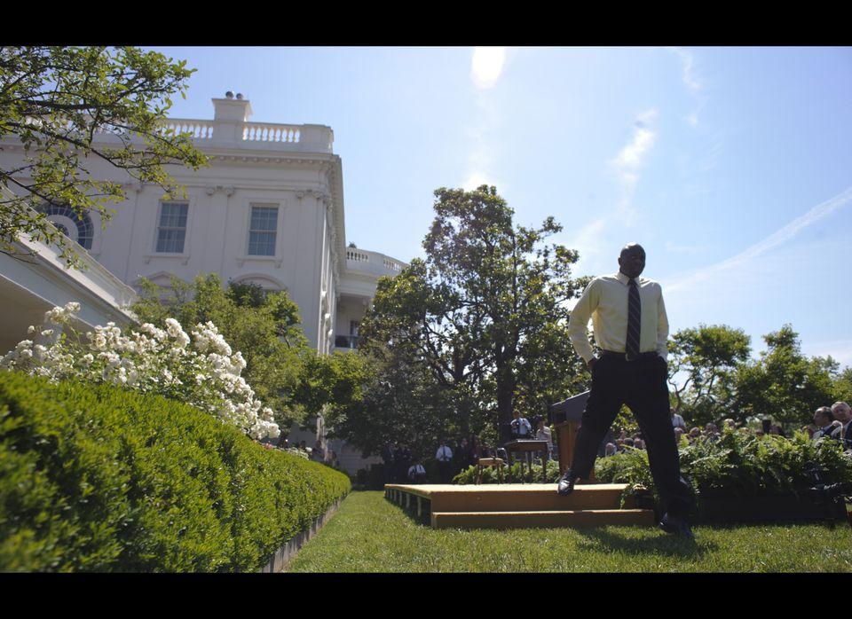 Presidential aide Reggie Love steps off the stage before US President Barack Obama signed a presidential memorandum on vehicl