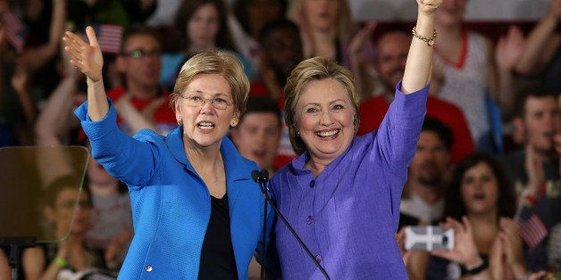 Democratic U.S. presidential candidate Hillary Clinton (R) stands along side US Senator Elizabeth Warren at a campaign rally