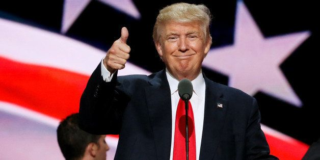 Republican presidential nominee Donald Trump gives a thumbs up during his walk through at the Republican National Convention