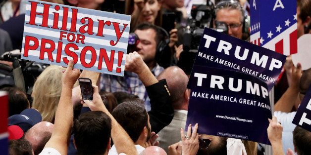 CLEVELAND, OH - JULY 19:  Delegates hold signs in support of presumptive Republican presidential candidate Donald Trump durin