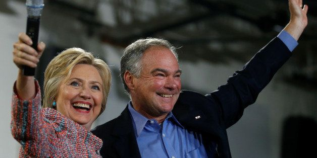 Democratic U.S. presidential candidate Hillary Clinton and U.S. Senator Tim Kaine (D-VA) wave to the crowd during a campaign