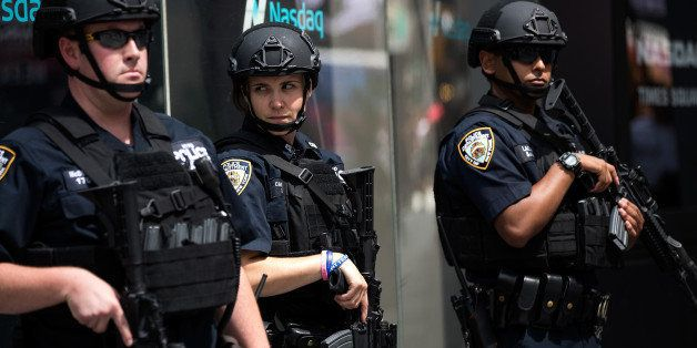 NEW YORK, NY - JULY 15: Members of the New York City Police Department stand guard in Times Square, July 15, 2016 in New York