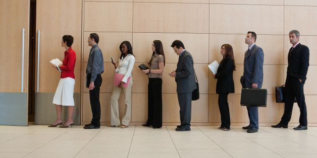 Businesspeople standing in line