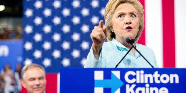 Democratic presidential candidate Hillary Clinton accompanied by Sen. Tim Kaine, D-Va., speaks at a rally at Florida Internat