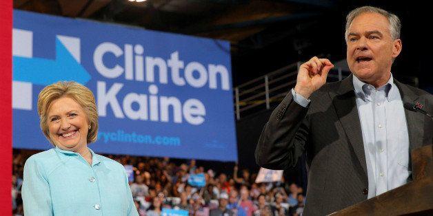 U.S. Democratic presidential candidate Hillary Clinton reacts as Democratic vice presidential candidate Senator Tim Kaine spe